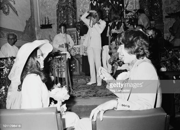 Mick and Bianca Jagger at their wedding at the Church of St Anne St Tropez 12th May 1971 In the background is British photographer Patrick Lichfield