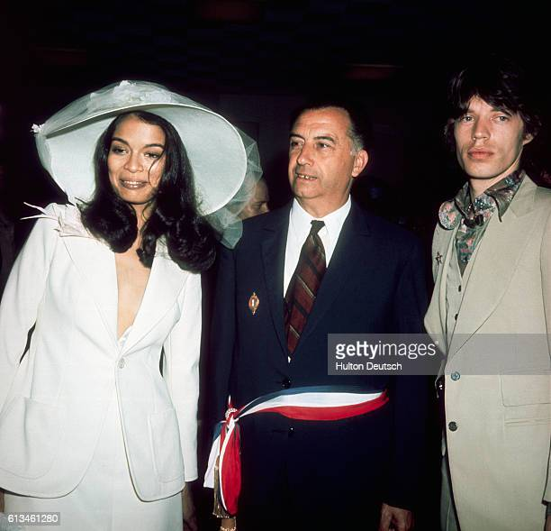 Mick and Bianca Jagger stand beside a second man at their wedding in 1971