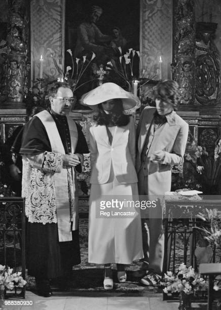 Mick and Bianca Jagger with the officiating priest at their wedding at the Church of St Anne St Tropez 12th May 1971