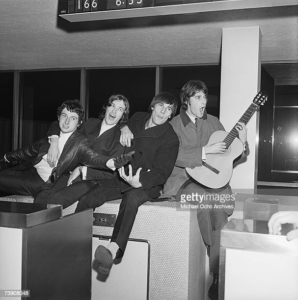 Mick Avory Dave Davies Peter Quaife Ray Davies of the rock group 'The Kinks' pose for a picture in the airport on their way to their first US tour in...