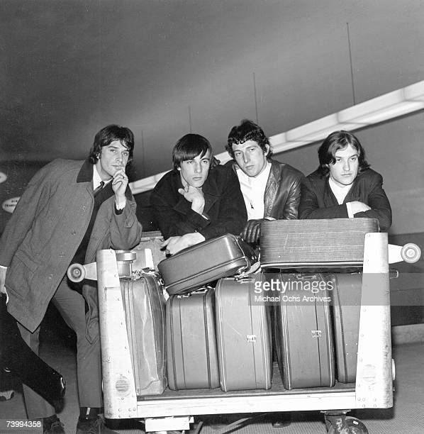 Mick Avory Dave Davies Peter Quaife Ray Davies of the rock group The Kinks pose for a picture in the airport on their way to their first US tour in...