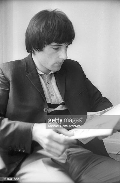 Mick Avory of the rock group The Kinks relax in their hotel room in August 1965 in New York New York