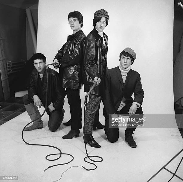 Mick Avory Peter Quaife Ray Davies Dave Davies of the rock group 'The Kinks' pose for a portrait session wearing black leather jackets in the studio...