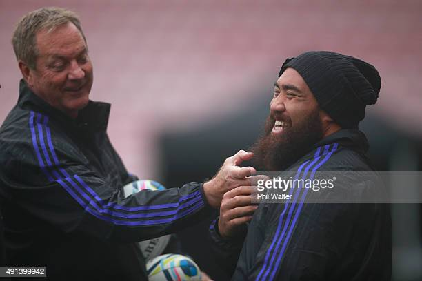 Mick Byrne adjusts the beard of Charlie Faumuina of the All Blacks during a New Zealand All Blacks training session at Mowden Park on October 5 2015...
