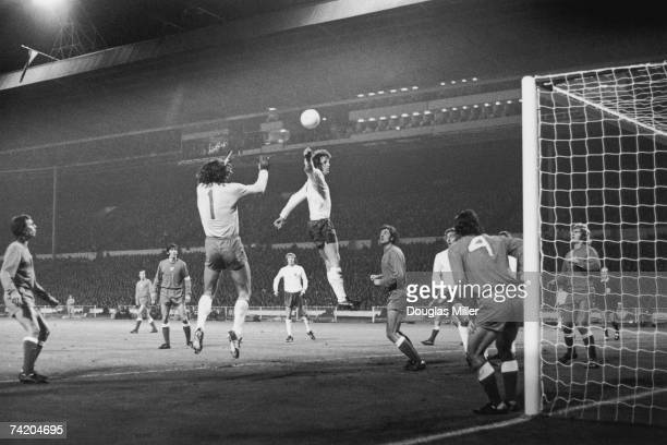 Mick Channon of England causes problems for the Polish defence during a World Cup qualifying match at Wembley, London, 17th October 1973. The final...