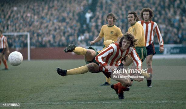 Mick Channon of Southampton is beaten to the ball by Jeff Butler of Norwich City during their fourth round League Cup football match at The Dell on...