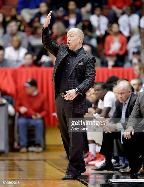 Mick Cronin the head coach of the Cincinnati Bearcats gives instructions to his team during the game against the Texas Southern Tigers at Fifth Third...