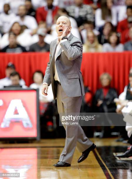Mick Cronin the head coach of the Cincinnati Bearcats gives instructions to his team during the game against the Connecticut Huskies at Fifth Third...