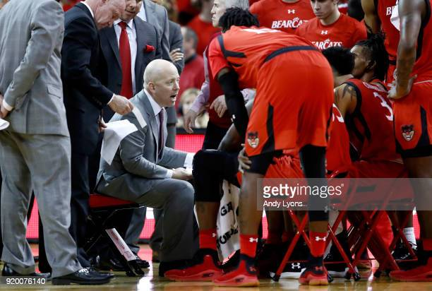 Mick Cronin the head coach of the Cincinnati Bearcats gives instructions to his team against the Witchita State Shockers during the game at BBT Arena...