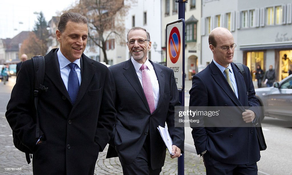 Mick Davis, chief executive officer of Xstrata Plc, center, reacts as he leaves with colleagues after a shareholder's meeting in Zug, Switzerland, on Tuesday, Nov. 20, 2012. Xstrata shareholders voted to approve this year's biggest takeover, combining the Zug, Switzerland-based company's coal, copper, nickel and zinc mining assets with Glencore's cotton-to-crude oil commodities trading empire. Photographer: Gianluca Colla/Bloomberg via Getty Images