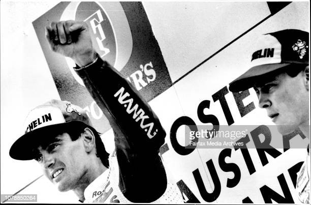 Mick Doohan wins grand prix at eastern creek Wayne Rainey trouble with back runners Doohan salutes the crowd watched by fellow Australian and third...