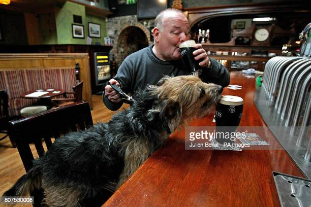 Mick Egan enjoys a pint with his pint loving dog 'Dfor' in the Mullingar House Pub in Chapelizod Dublin as details emerge that festival organisers...