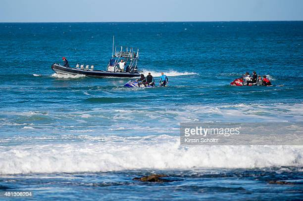 Mick Fanning and Julian Wilson both of Australia safely on the jetskis after Fanning was attacked by a shark at the JBay Open on July 19 2015 in...
