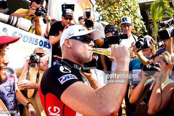 Mick Fanning of Australia celebrates his ASP World Title victory with a Corona beer at the Billabong Pipeline Masters on December 12 2009 in Pipeline...