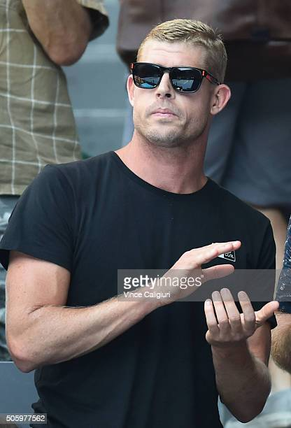 Mick Fanning of Australia is seen watching the second round match between Sam Groth of Australia and Andy Murray of Great Britain during day four of...