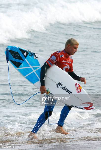 Mick Fanning of Australia runs up the beach during Round Two of the Rip Curl Pro as part of the ASP World Tour held at Bells Beach March 21 2008 in...