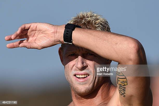 Mick Fanning of Australia watches the surf at Snapper Rocks on February 23 2015 on the Gold Coast Australia