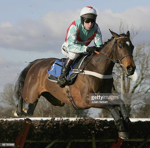 Mick Fitzgerald and Afsoun clear an early flight before landing The Betfred Chatters Fen Juvenile Novices Hurdle Race run at Huntingdon Racecourse on...