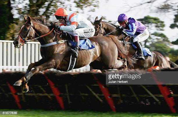 Mick Fitzgerald and Gallery God lead the Noel Fehily ridden Latzod'alm over the last flight before landing The Sharp Minds Phone 0870 9080121 Novices...