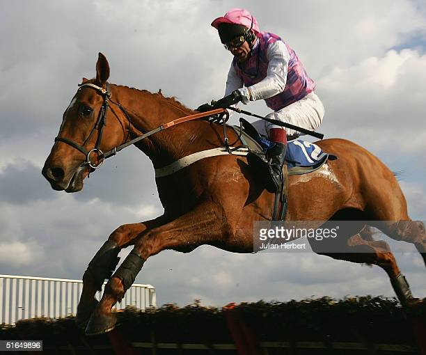 Mick Fitzgerald and The Market Man clear the last flight bgefore landing The Countryside Alliance Novices' Hurdle at Kempton Racecourse on November 3...