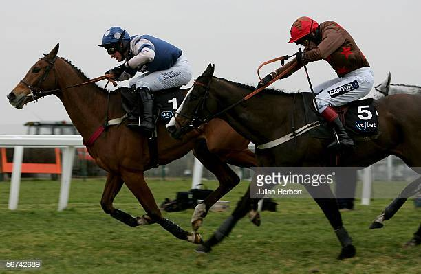 Mick Fitzgerald and Tysou catch the Andrew Tinkler ridden Dempsey to land The Victor Chandler Handicap Steeple Chase Race run at Sandown Park...