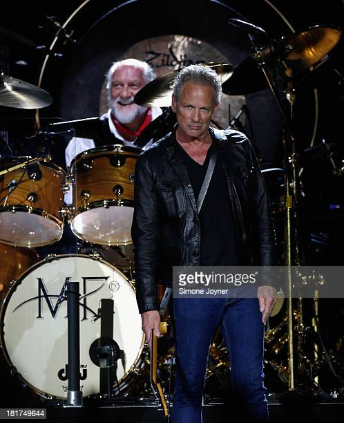 Mick Fleetwood, and Lindsey Buckingham of Fleetwood Mac perform live on stage at 02 Arena on September 24, 2013 in London, England.