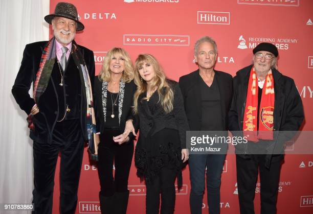 Mick Fleetwood Christine McVie Stevie Nicks Lindsey Buckingham and John McVie of music group Fleetwood Mac attend MusiCares Person of the Year...