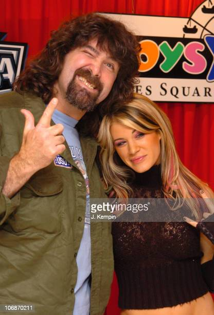 Mick Foley and Diva Ashley during WWE RAW Superstar Mick Foley and Diva Ashley Celebrate Wrestlemania 22 March 23 2006 at Toys R Us Times Square in...