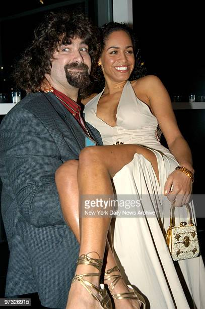 Mick Foley lifts Luz Whitney at the 7th Annual Muscular Dystrophy Association's Muscle Team Gala and Benefit Auction held at Chelsea Pier Sixty