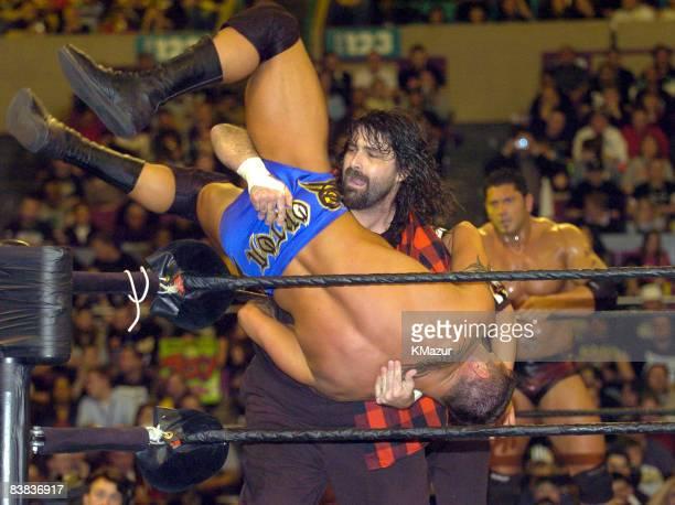 Mick Foley prepares to slam Randy Orton