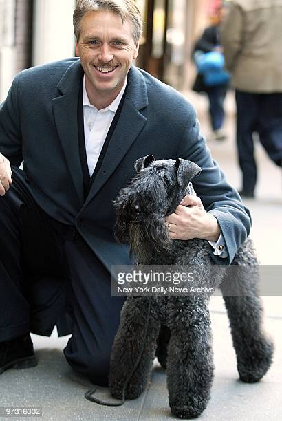 Mick fresh from last night's triumph at the 127th Westminster Kennel Club Dog Show arrives with handler Bill McFadden for a steak lunch at Sardi's...
