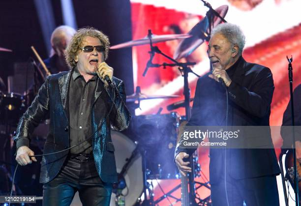Mick Hucknall and Sir Tom Jones perform on stage during Music For The Marsden 2020 at The O2 Arena on March 03, 2020 in London, England.