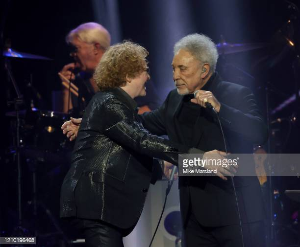 Mick Hucknall and Tom Jones attend the Music For Marsden 2020 at The O2 Arena on March 03, 2020 in London, England.