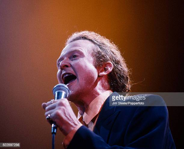 Mick Hucknall of Simply Red performing on stage at the Wembley Arena in London, circa 1992.