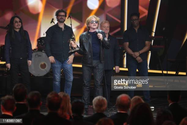 Mick Hucknall of Simply Red with award on stage during the 71st Bambi Awards show at Festspielhaus BadenBaden on November 21 2019 in BadenBaden...