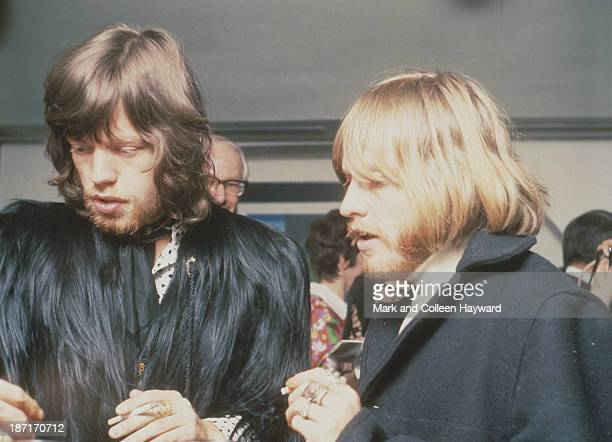 Mick Jagger and Brian Jones from The Rolling Stones stand together at a party to celebrate the cabaret debut of the Supremes on Kings Road Chelsea on...
