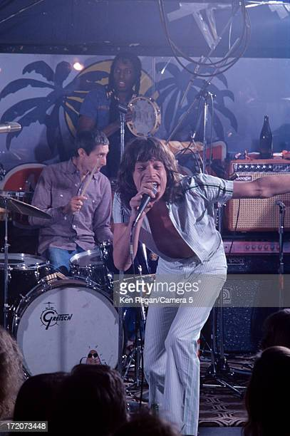Mick Jagger and Charlie Watts of the Rolling Stones are photographed on stage at El Mocambo Tavern in March 1977 in Toronto Ontario CREDIT MUST READ...