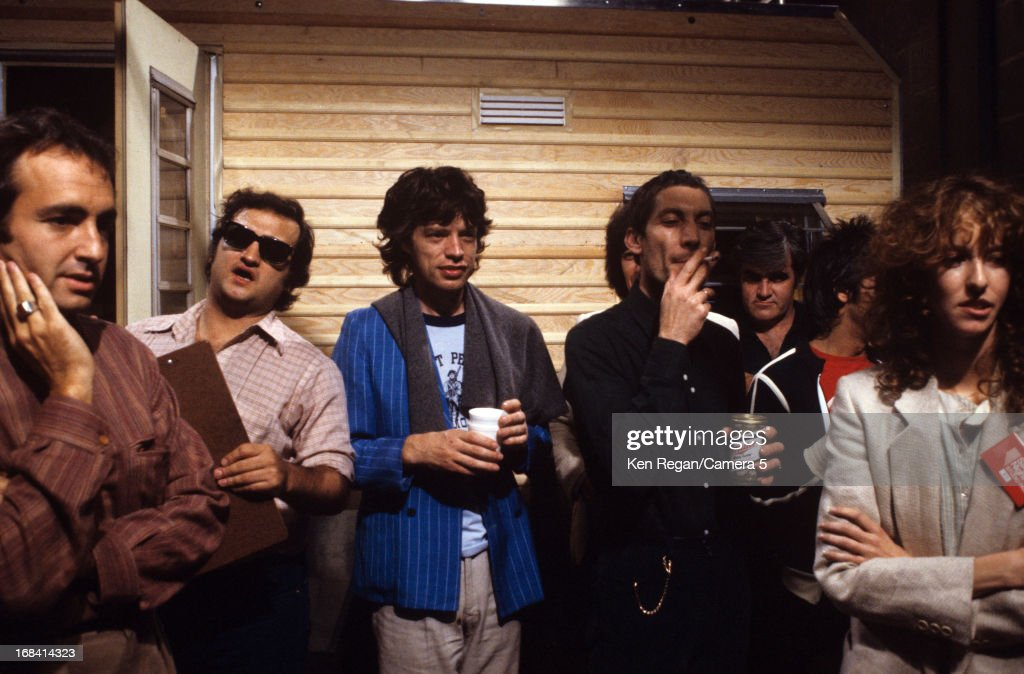 Mick Jagger and Charlie Watts of the Rolling Stones, Loren Michaels, John Belushi and Loraine Newman are photographed on the set of Saturday Night Live on October 7, 1978 in New York City.