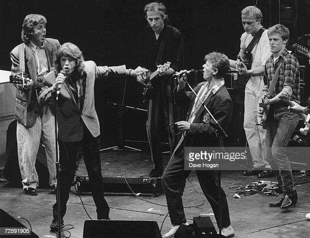 Mick Jagger and David Bowie duet with an allstar band at at the Prince's Trust Concert Wembley 23rd June 1986 Left to right Paul McCartney Mick...