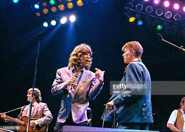 Mick Jagger and David Bowie with Paul McCartney on left performing on stage at The Prince's Trust 10th Birthday Party at Wembley Arena London United...