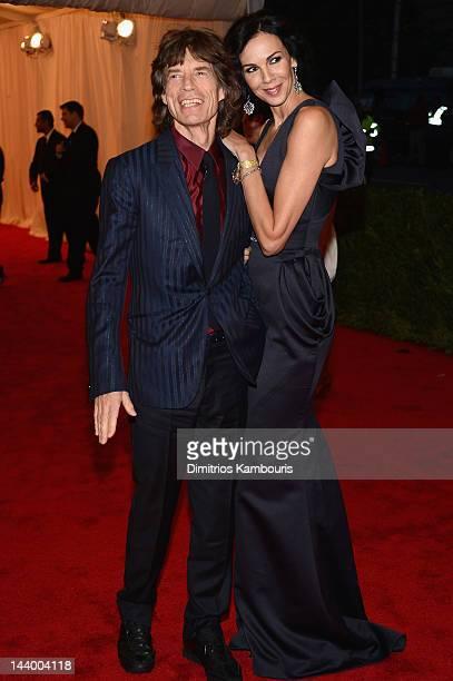 Mick Jagger and designer L'Wren Scott attends the 'Schiaparelli And Prada Impossible Conversations' Costume Institute Gala at the Metropolitan Museum...