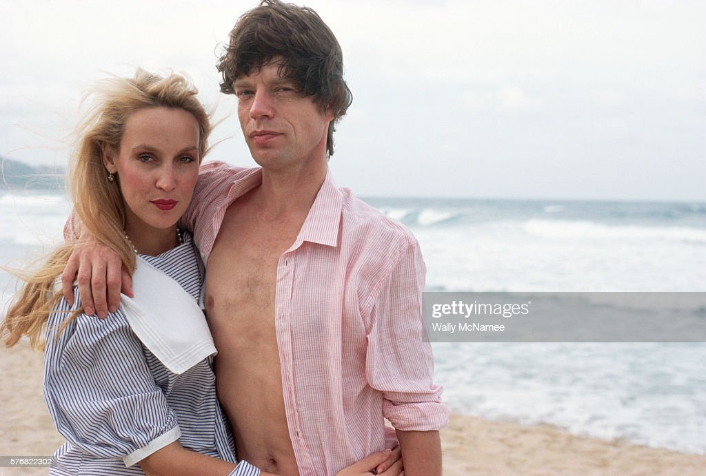 Mick Jagger and girlfriend Jerry Hall on the beach at Barbados, just prior to his 40th birthday.