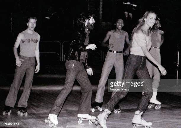 Mick Jagger and Jerry Hall roller skating circa 1975 in New York.