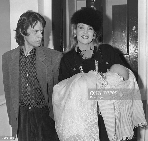Mick Jagger and Jerry Hall with one of their children circa 1985