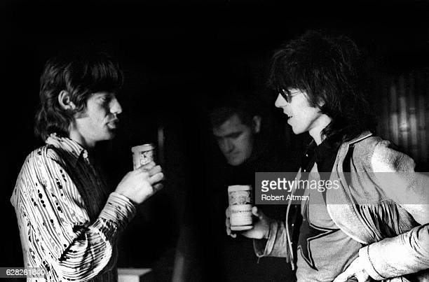 "Mick Jagger and Keith Richards of The Rolling Stones drink Budweiser as Ian Stewart looks on during the ""Let It Bleed"" sessions at the Elektra..."