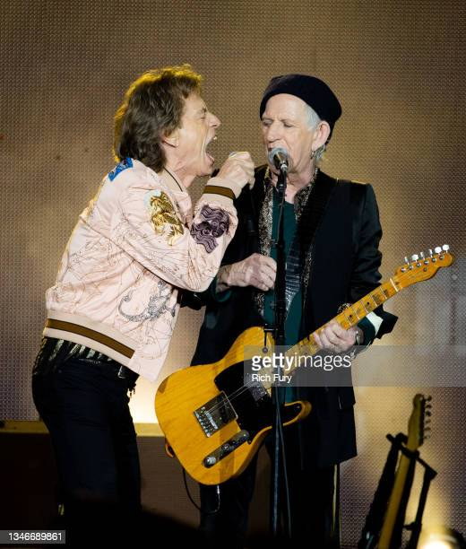 Mick Jagger and Keith Richards of The Rolling Stones perform onstage at SoFi Stadium on October 14, 2021 in Inglewood, California.