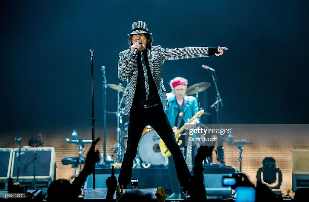 Mick Jagger and Keith Richards (R) of The Rolling Stones performs live on stage at the first of their 50th Anniversary concerts at the O2 Arena on November 25, 2012 in London, England.