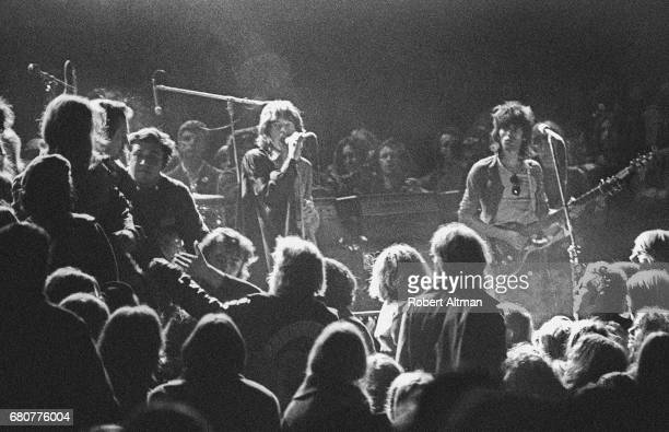 Mick Jagger and Keith Richards of the Rolling Stones warily eye the Hells Angels onstage at The Altamont Speedway on December 6 1969 in Livermore...
