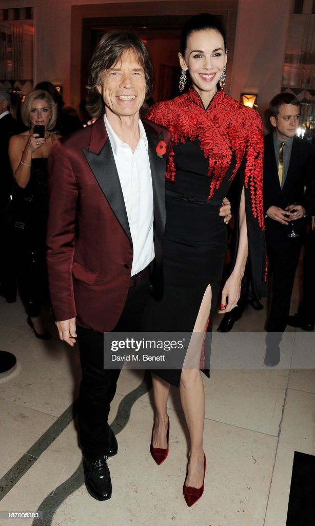 Mick Jagger (L) and L'Wren Scott arrive at the Harper's Bazaar Women of the Year awards at Claridge's Hotel on November 5, 2013 in London, England.