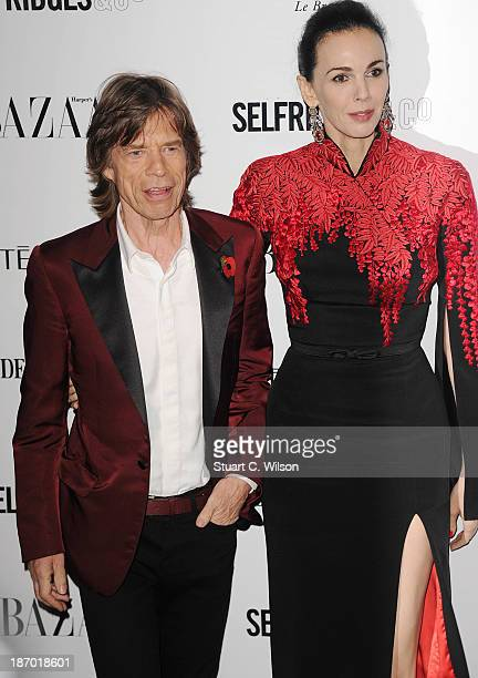 Mick Jagger and L'Wren Scott arrive for the Harpers Bazaar Women Of The Year Awards at Claridges Hotel on November 05 2013 in London England